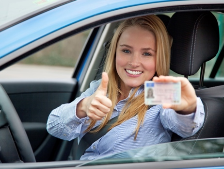 image of girl holding drivers license