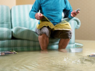 image of man sitting in flooded house