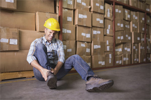 warehouse employee sitting down hurt on the job